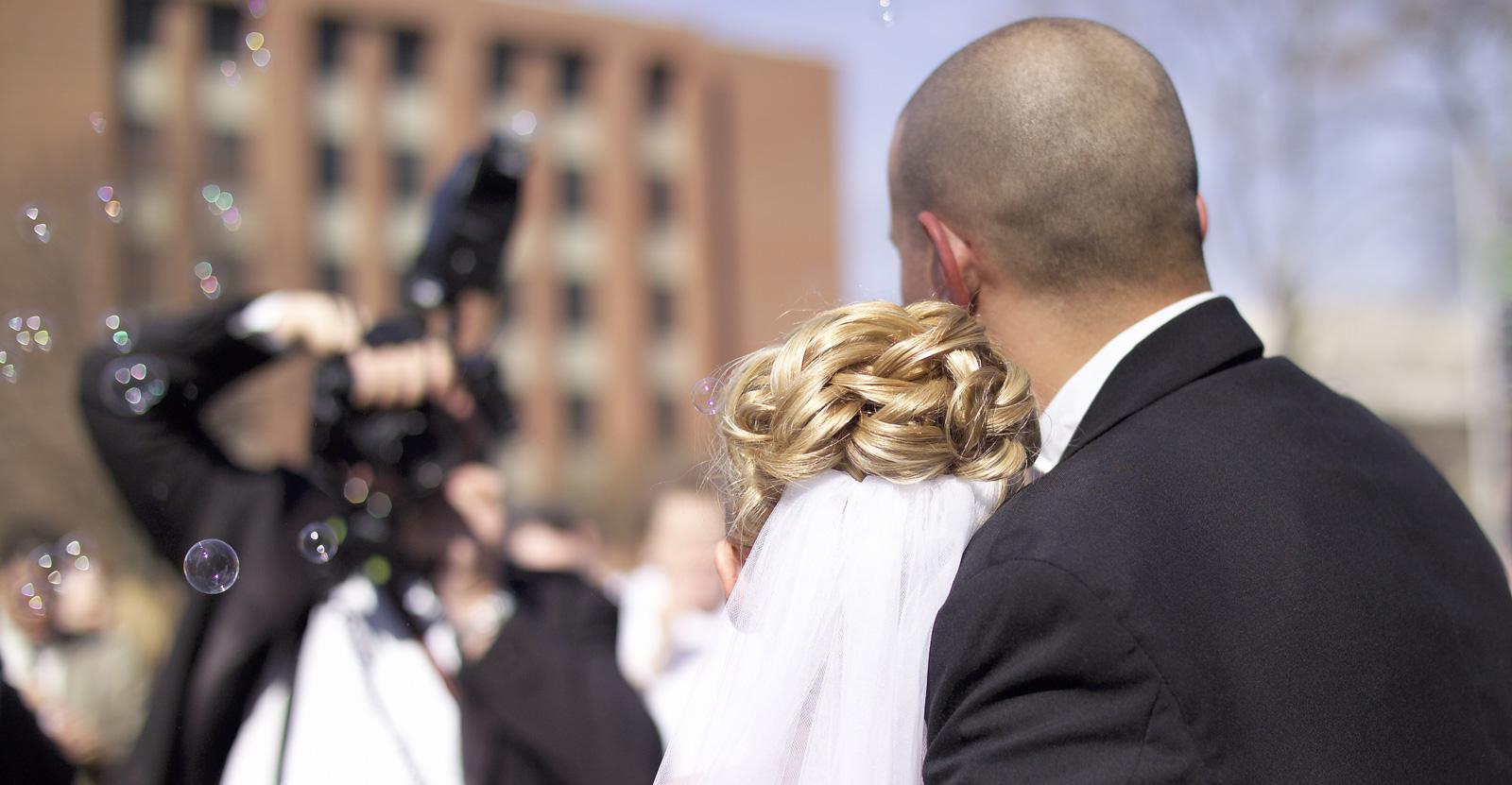 Wedding-Couple-With-Photographer